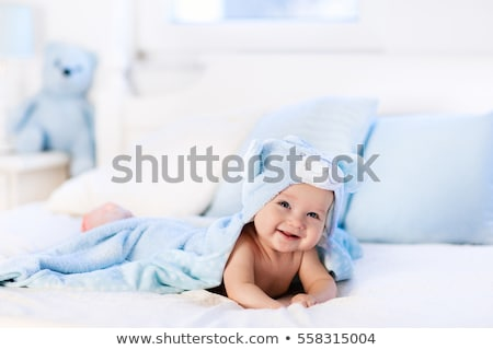baby with blue towel stock photo © dolgachov