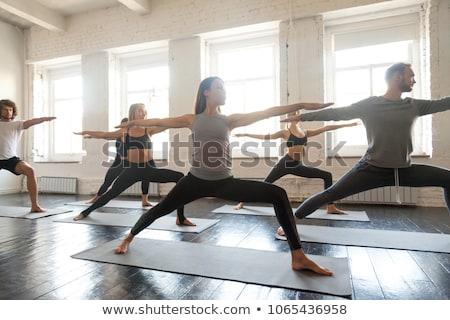 Vrouw yoga krijger buitenshuis geschikt Stockfoto © dmitry_rukhlenko