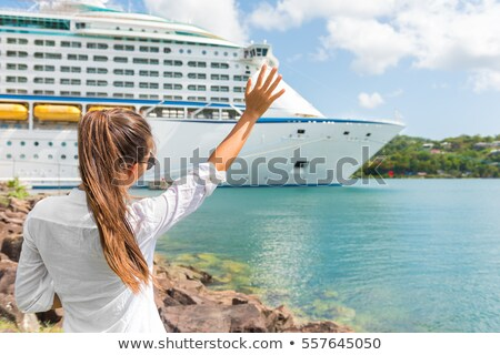 Happy joyful woman waving hello or goodbye hand sign to cruise ship. Caribbean luxury travel vacatio Stock photo © Maridav