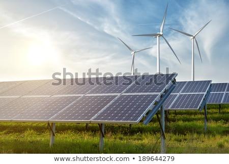 Wind power generator under sunset Stock photo © Ansonstock