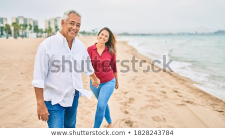 Kadın yürüyüş plaj gökyüzü su seksi Stok fotoğraf © pedromonteiro