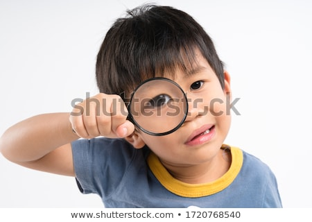 boy looks through  magnifier with interest Stock photo © Paha_L