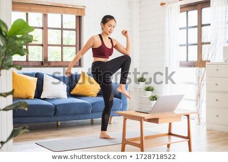 Aerobik testmozgás fiatal vonzó nő súlyzók izolált Stock fotó © rognar