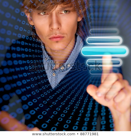 Young business man pressing a touchscreen button while working a Stock photo © HASLOO