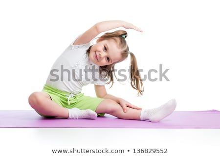 Cute young fitnes girl doing exercises. Stock photo © lithian
