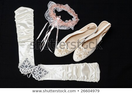 Stock photo: white shoes gloves and a garter