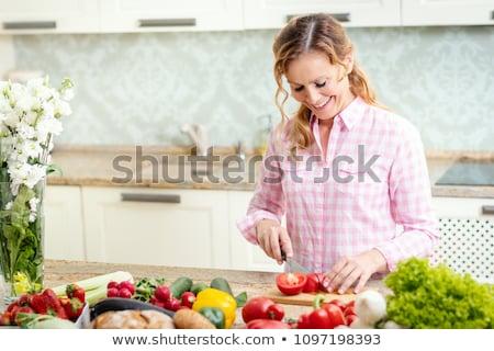 happy woman chopping tomato stock photo © rob_stark
