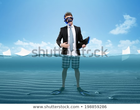 full length portrait of young man wearing goggles stock photo © stockyimages