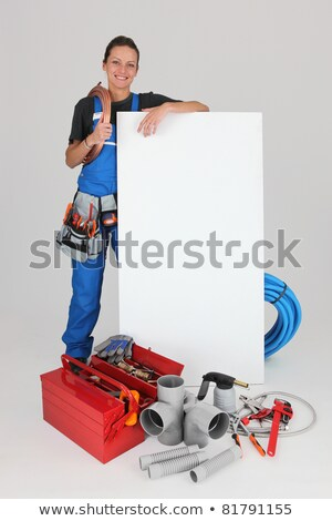 smiling female plumber with panel for message stock photo © photography33
