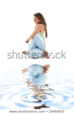 half lord of the fishes pose on white sand Stock photo © dolgachov
