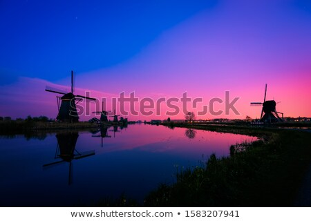 windmill sunrise stock photo © kenneth_keifer