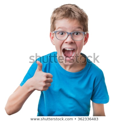 adorable young caucasian boy showing thumbs up sign stock photo © stockyimages