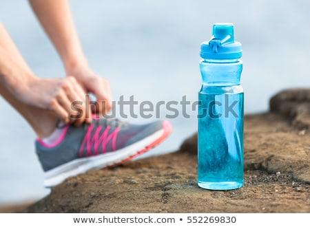 женщину · бутылку · воды · Focus · привлекательный - Сток-фото © wavebreak_media