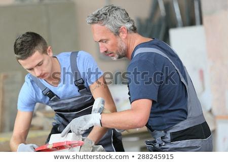 Jeunes apprenti maçon homme heureux construction Photo stock © photography33