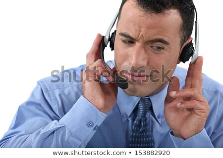 Businessman struggling to hear his headset Stock photo © photography33