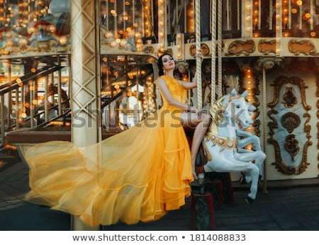 young woman sitting on a carousel stock photo © acidgrey
