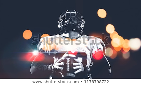american football helmet on field stock photo © dehooks