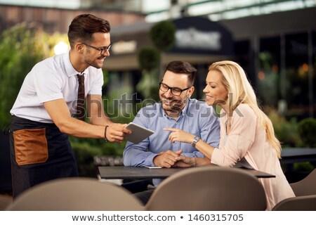 Stock photo: Waiter showing menus