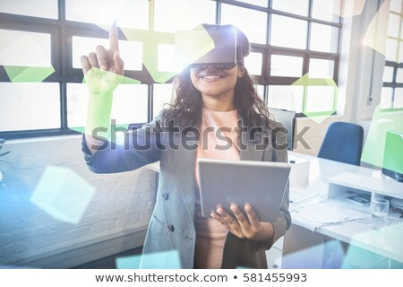 Beautiful woman using a virtual screen Stock photo © dash