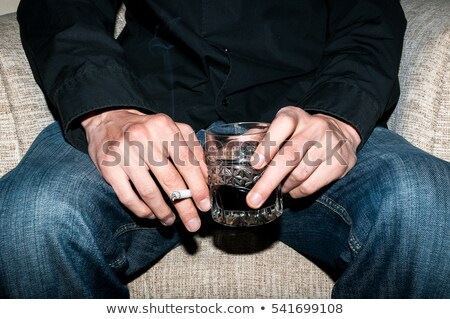 Man with glass of alcohol Stock photo © velkol