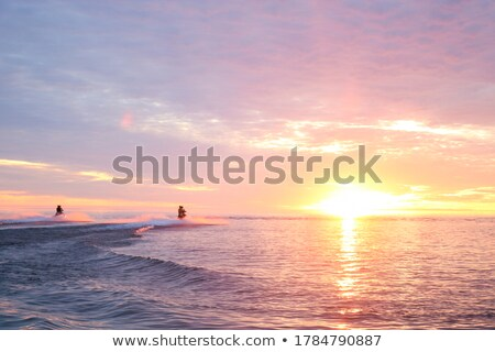 Stock photo: Jetski  and sunset