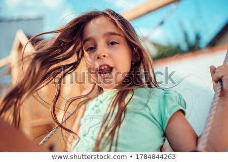 Wesoły dziewczynka wysoki w górę huśtawka pływające Zdjęcia stock © gophoto