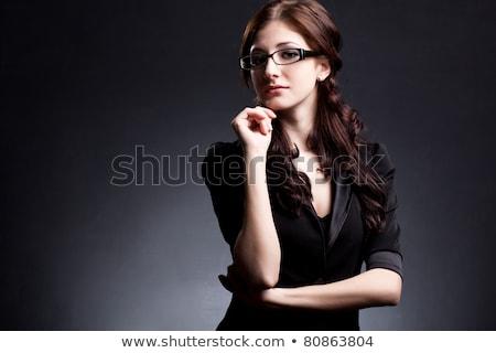 Brunette girl posing over black background. Stock photo © PawelSierakowski
