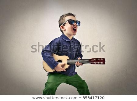 rocker · rocksztár · fiatalember · napszemüveg · ezüst · fal - stock fotó © lunamarina