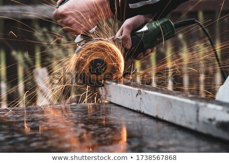 A male construction worker with a grinder. Stock photo © photography33
