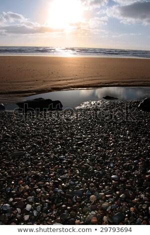 Donkere gouden strand zonsondergang schilderachtig Stockfoto © morrbyte