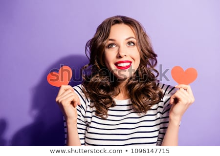 Beautiful woman in a heart cutout Stock photo © stryjek