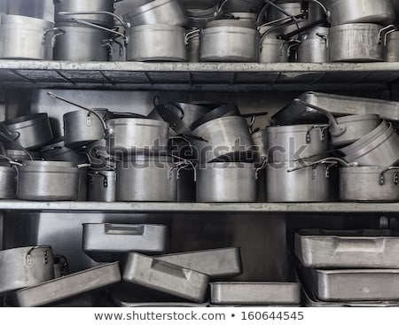 shelves cluttered with pots and pans Stock photo © epstock