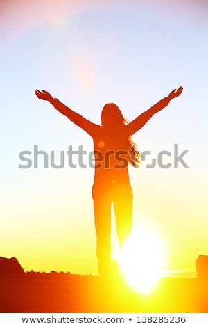 Happy worshipping praising joyful elated woman Stock photo © Maridav