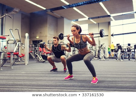 Barbell man vrouw training fitness gymnasium Stockfoto © lunamarina