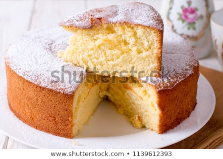 Sponge cake on wooden background Stock photo © homydesign