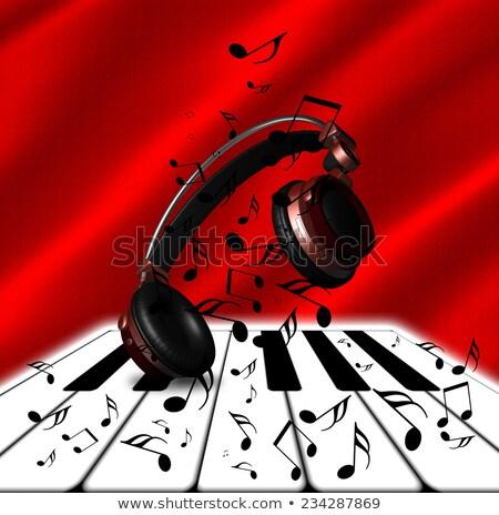 Valósághű piros fejhallgató hangjegyek zongora hangszóró Stock fotó © ankarb