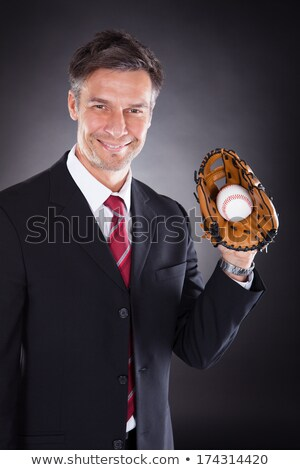 Businessman Holding Baseball And Mitt Stock photo © AndreyPopov