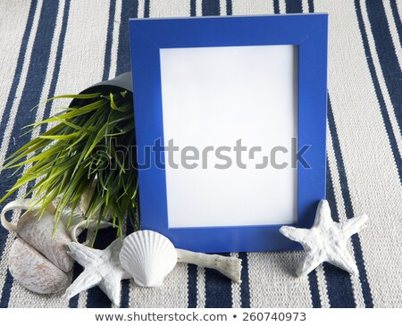 Beautiful Collage With Blue Photo Frame On Old Vintage Rug Stock fotó © mcherevan