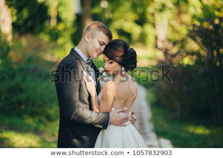 Gorgeous bride dancing, holding a rose Stock photo © lightpoet