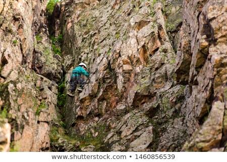 Fiatal srác mászik erdő fa sport kő Stock fotó © Marfot