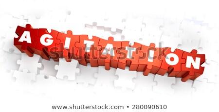 agitation   word on red puzzles stock photo © tashatuvango