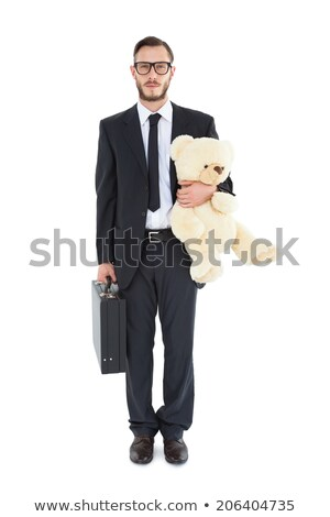 Geeky businessman holding briefcase and teddy Stock photo © wavebreak_media