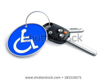 Set of car keys with keyring and a wheelchair icon on it. Concep Stock photo © crashtackle