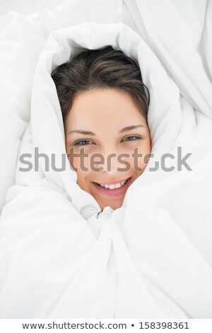 Portrait of beautiful natural woman wrapped in white duvet  Stock photo © deandrobot