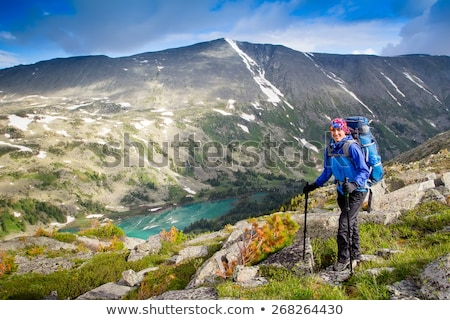 Woman hiker with a backpack and walking stick on the Black Lake  Stock photo © vlad_star