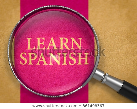 learn spanish through loupe on old paper stock photo © tashatuvango