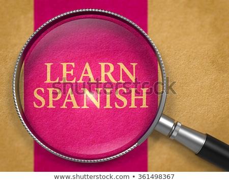 Foto stock: Aprender · espanhol · lupa · papel · velho · vertical