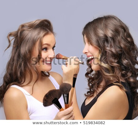 Fun with makeup brush Stock photo © photosebia