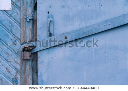 Steel stripped texture locked door  Stock photo © nalinratphi
