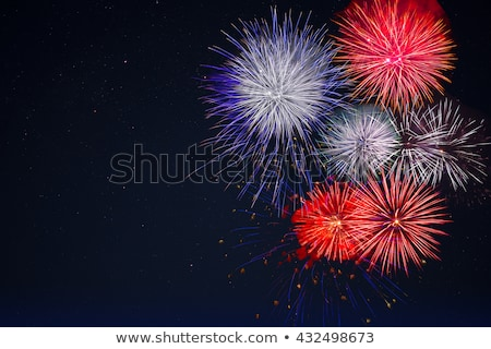 Celebration Fireworks Over Night Sky Copy Space Photo stock © TasiPas